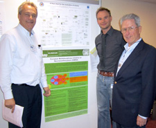 Adrian Danek, Benedikt Bader and Glenn Irvine with two posters by Ruth Walker and Adrian and Benedikt