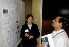 Mithu De explaining her poster to Mohan Narla